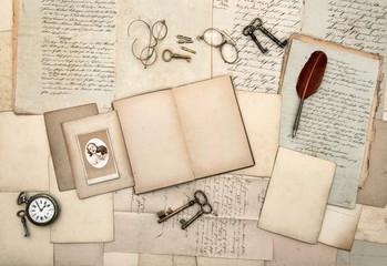 open book, old letters, postcard, photo, keys, clock