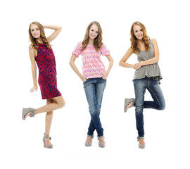 portrait of beautiful three blonde girl in jeans posing