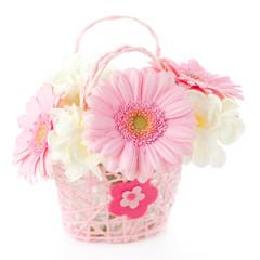 PInk gerberas in pink basket on white background
