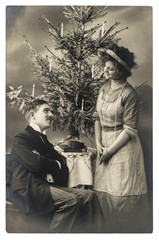 young couple celebrated with christmas tree. vintage picture