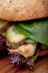 Chicken burger with lettuce and pickles