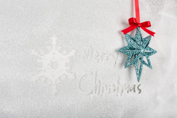 """Snow on the frozen window with word """" Merry Christmas """" and snow"""