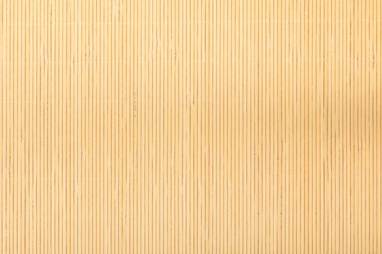 Close up beige bamboo mat striped background texture pattern