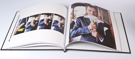 Wedding photo book of elegant young caucasian groom