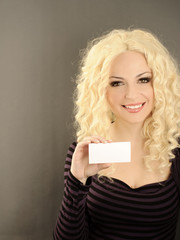 Pretty girl holding blank business card
