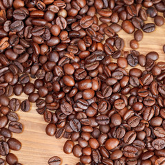 roasted coffee beans close up on wooden board
