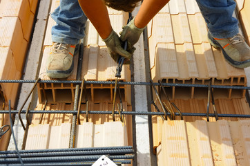 Worker engaged in the construction of a slab and masonry