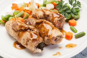 Pork rolls and vegetables