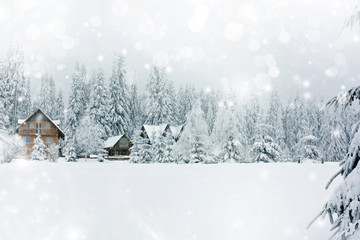 Winter landscape with snowy fir trees and mountain cottage