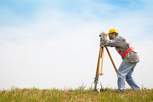 Surveyor engineer making measure on the field