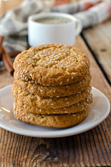 Cookies on a wooden table with a cup of coffee