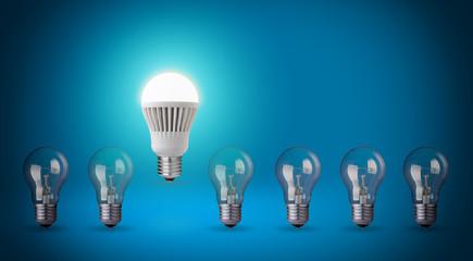 Row with light bulbs and LED bulb. Idea concept on blue backgrou