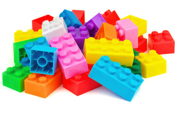 Plastic colorful toy blocks on white background