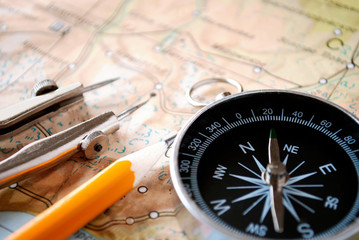 Compass and pencil on a map