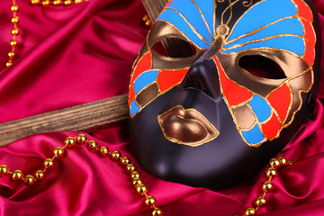 Mask on bright pink fabric background