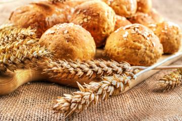 Fresh homemade buns with wheat ears