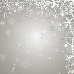 Abstract  winter ligth background with various snowflakes.