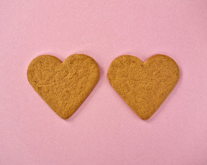 heart shaped cookies on pink background