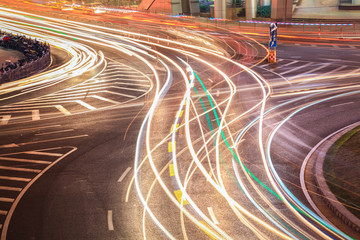 Fotomurales - light trails on the roundabout road