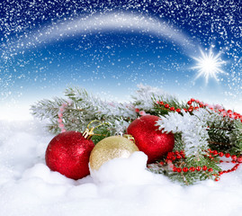 Christmas card with balls and star in the sky