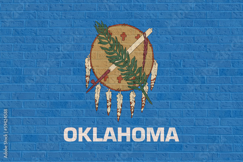 Wall mural Oklahoma state flag on brick wall