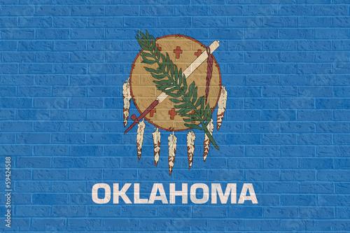 Fototapete Oklahoma state flag on brick wall
