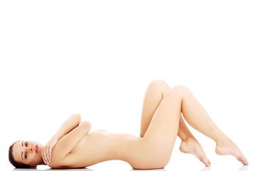 Beautiful naked slim woman lying.