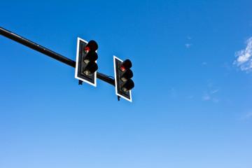 Traffic lights on blue sky background