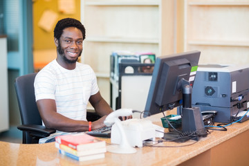Male Librarian Working At Desk
