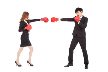 Business woman with boxing gloves having a fight with man