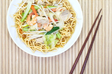 Chinese style deep fried yellow noodles with pork
