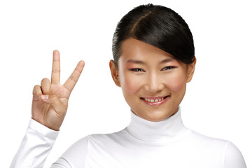 Beautiful happy asian girl showing victory positive sign