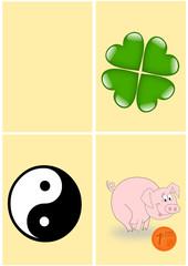 Karte gelb mit verschiedenen Glücksbringern
