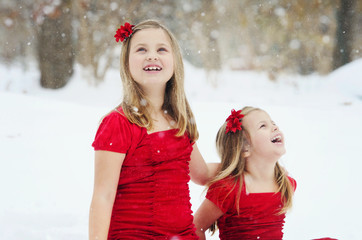 Little Girls Laughing in Snow