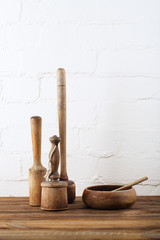 mashers retro kitchen utensils  on old wooden table in rustic st