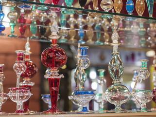 Ornate perfume bottles on a shelf