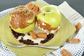Homemade taffy apples, on napkin, on wooden background
