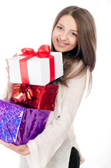 Beautiful young girl with gifts in hand