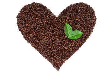 Heart made from coffee beans and green leaves.