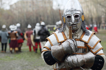 Warrior in armor and helmet at Battle