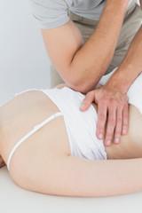 Physiotherapist massaging a woman's back