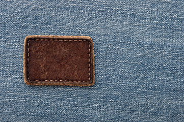 Leather jeans label sewed on jeans.