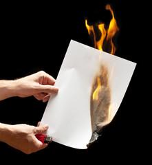 Man hand holding lighter and white burned paper