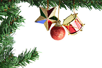 The Star,balls and drums hanging on Christmas tree.