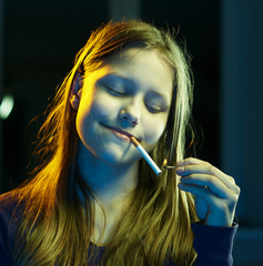 Teenager girl with a cigarette