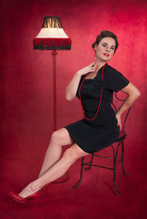 Pinup Girl in Black Dress with Lamp