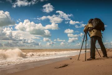 Landscape photographer work on sea coast