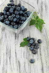 Blueberries in glass bowl on wooden table