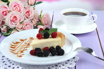 Slice of cheesecake with raspberry and blackberry
