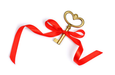 golden key with red ribbon